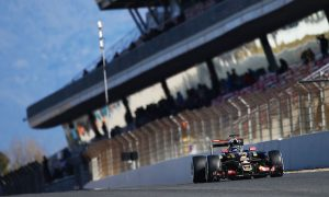 Grosjean puts Lotus top again following Alonso crash