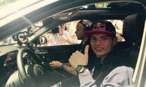 Verstappen behind the wheel of a BMW