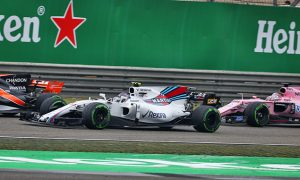 Stroll's Shanghai début ends early after clash with Perez