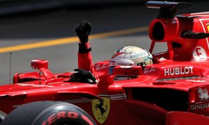 Vettel, Ferrari extend lead in championships