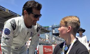 Grand Marshal Mark Webber greets a special guest
