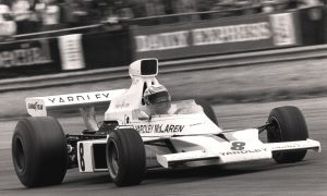 Revson clears first-lap chaos to win maiden GP