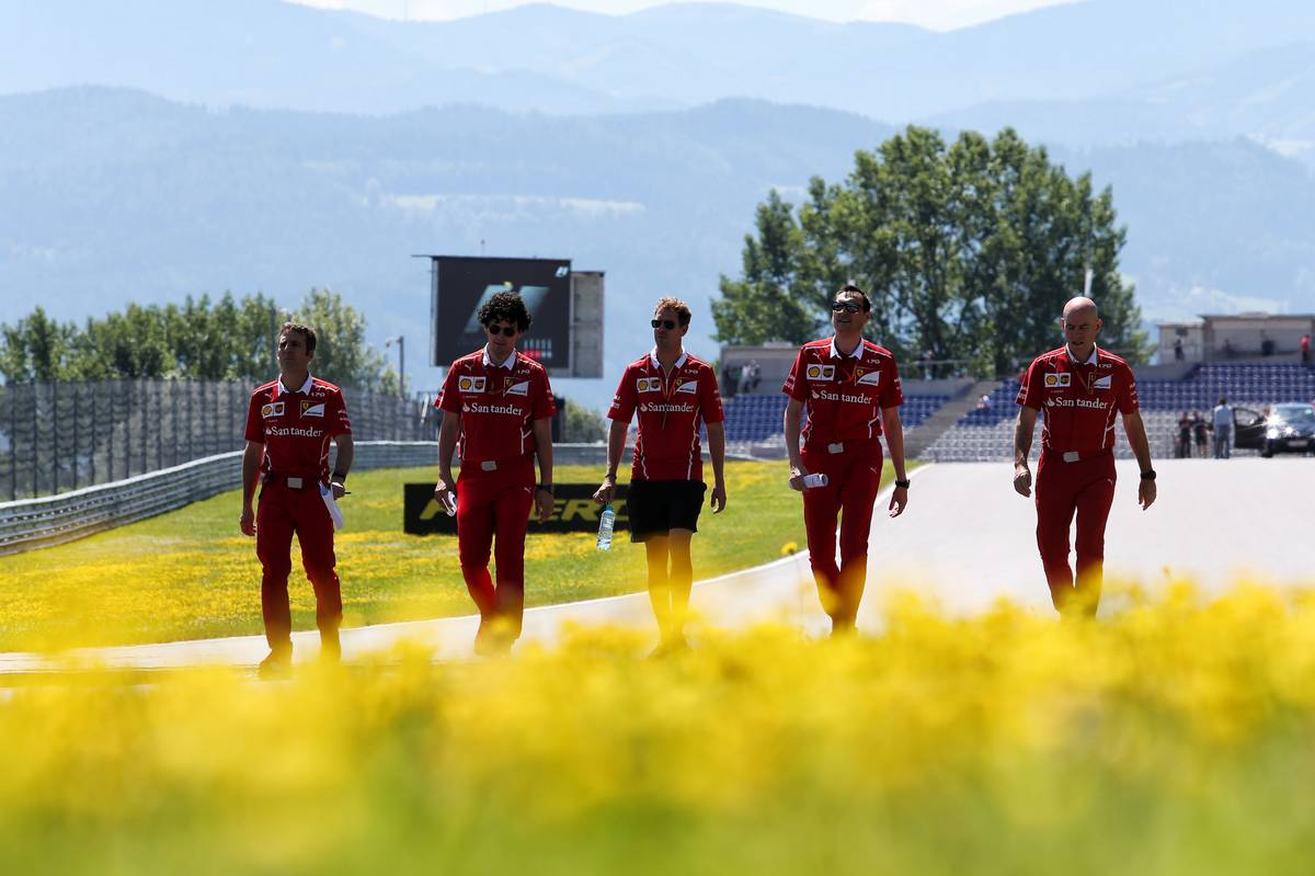 Sebastian Vettel (GER) Ferrari walks the circuit with the team. 06.07.2017. Formula 1 World Championship, Rd 9, Austrian Grand Prix, Spielberg, Austria, Preparation Day. - www.xpbimages.com, EMail: requests@xpbimages.com - copy of publication required for printed pictures. Every used picture is fee-liable. © Copyright: Moy / XPB Images
