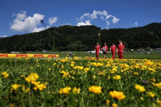 Sebastian Vettel (GER) Ferrari walks the circuit with the team.