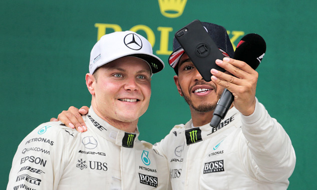 Mercedes team mates Valtteri Bottas and Lewis Hamilton celebrate on the podium after the 2017 British Grand Prix
