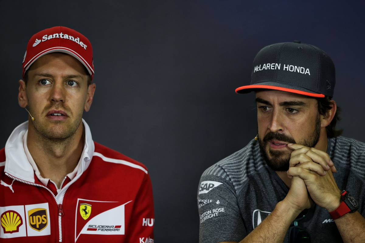 (L to R): Sebastian Vettel (GER) Ferrari with Fernando Alonso (ESP) McLaren in the FIA Press Conference. 27.07.2017. Formula 1 World Championship, Rd 11, Hungarian Grand Prix, Budapest, Hungary, Preparation Day. - www.xpbimages.com, EMail: requests@xpbimages.com - copy of publication required for printed pictures. Every used picture is fee-liable. © Copyright: Moy / XPB Images