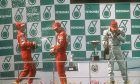 Michael Schumacher, Eddie Irvine and Mika Hakkinen on the podium - 1999 Malaysian Grand Prix at Sepang