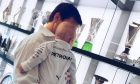 Mercedes boss Toto Wolff shows son Jack what daddy gets up to at the office.