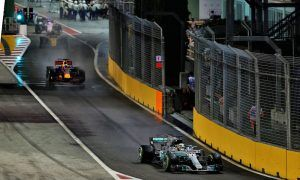 Mercedes' Lewis Hamilton and Red Bull's Daniel Ricciardo exit pit lane during the Singapore Grand Prix