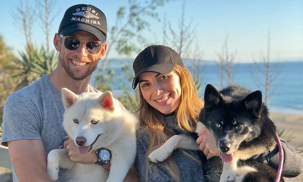 Jenson Button, girlfriend Brittny Ward, and dogs Storm and Rogue