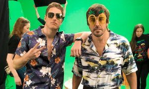 McLaren drivers Stoffel Vandoorne and Fernando Alonso take part in a photo shoot for new sponsors Gandys