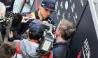 Max Verstappen (NLD) Red Bull Racing with the media.