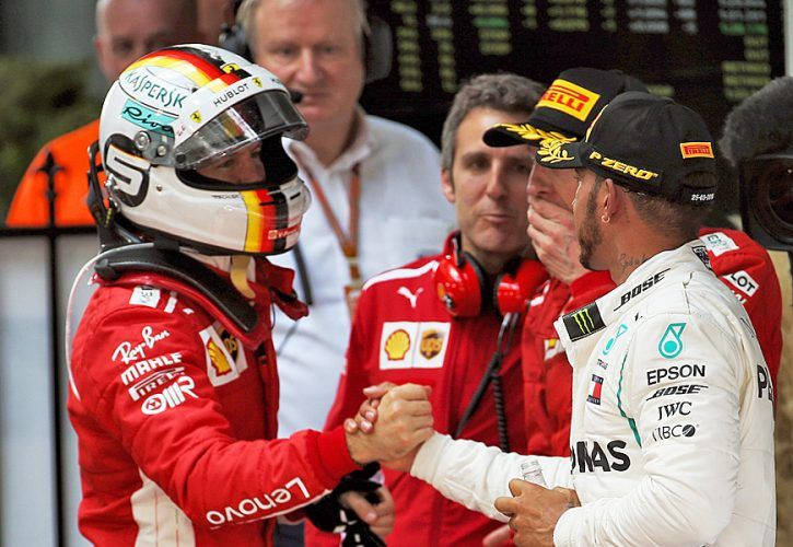 (L to R): Race winner Sebastian Vettel (GER) Ferrari celebrates with Lewis Hamilton (GBR) Mercedes AMG F1 in parc ferme.
