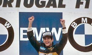 Aryton Senna celebrates victory in the 1985 Portugal Grand Prix