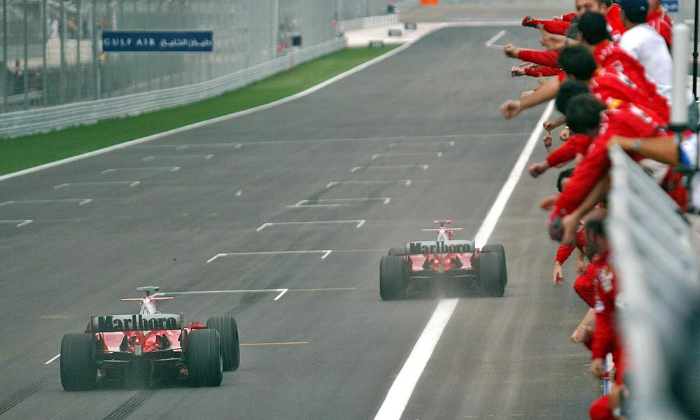 2004 Bahrain GP finish: Rubens Barrichello, BRA, Ferrari and Michael Schumacher, GER, Scuderia Ferrari