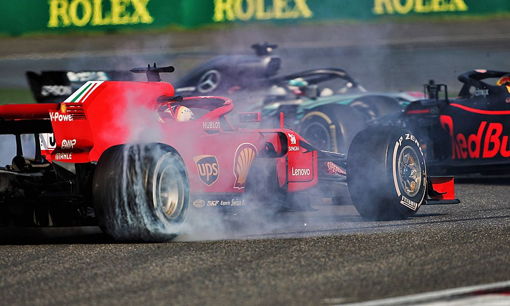 Max Verstappen (NLD) Red Bull Racing RB14 and Sebastian Vettel (Ferrari) collide