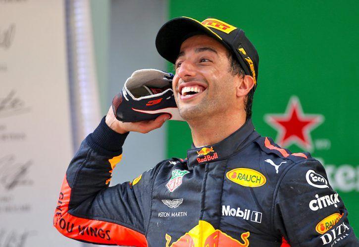 Daniel Ricciardo (AUS) Red Bull Racing celebrates on the Chinese Grand Prix podium