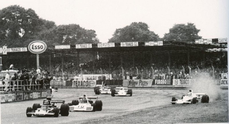 As Scheckter runs wide on the exit of Woodcote, mayhem is about to ensure...